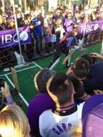 Kings owner Vivek Ranadive gives a cricket demonstration at the team's home opener. (Oct. 30, 2013)