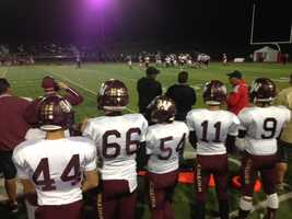 Whitney High School players on the sideline during their team's game against Antelope.