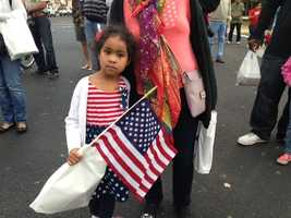 Felicity Treadwell, 5, of Sacramento, carries a flag and wears an outfit that shows her Veterans Day spirit at the downtown Sacramento parade (Nov. 11, 2013).