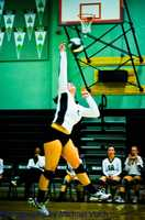 #15 - A Dixon Rams volleyball player gets up to smash the ball at her opponents.
