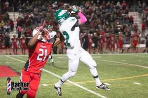 #4 - El Camino High School's Yosef Lanham grabs this ball despite some tough Cordova Lancer defense.