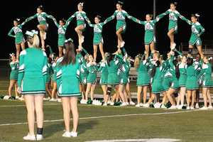 #9 - St. Mary's Rams cheerleaders set up for a nearly picture perfect stunt.