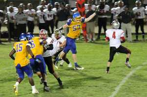 #14 - Andrew Stillman of Del Campo jumps out to put some pressure on the opposing quarterback.
