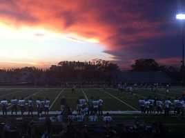 #47 - A vibrant sunset lit up the sky above the Elk Grove Thundering Herd vs. Franklin Wildcats game.