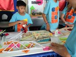 Junior scientists build bridges from paper at the conference in Sacramento.