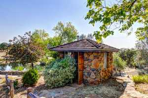 A hobbit-style home is also on the 21-acre property.