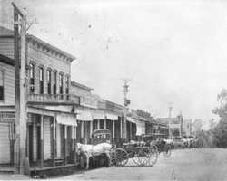 Folsom suffered heavily from fires, including one in 1866 that burned a number of buildings on Sutter Street. By the time this photo was taken in 1890, many of the buildings were rebuilt.