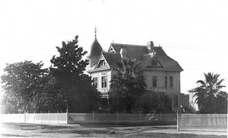 James H. Burnham settled in Folsom in the early 1860s and established himself as the town's first pharmacist. He built this three-story home, known as the Burnham House, on Figueroa Street in 1891, which was when this photo was taken.