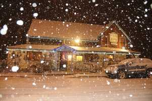 Snow falls in front of a restaurant in Quincy, Calif. (Dec. 7, 2013)