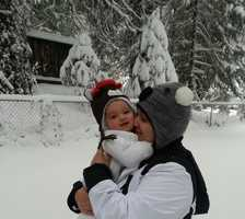 "The photo was titled ""Baby's First Snowfall""."