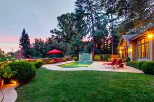 This home is one of six executive residences that sit in a quiet, gated knoll top that was once the bank of the American River.