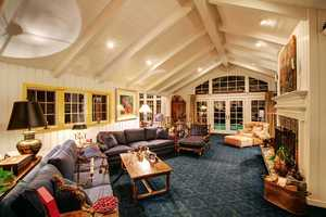 Among the lovely additions is a family room with beautiful white paneled walls.