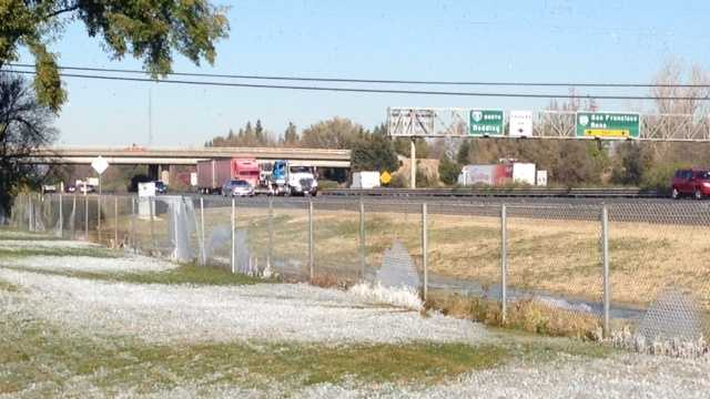 Icy patches formed by water sprinklers were visible along Interstate 5, just north of Garden Highway.