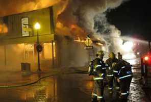 Flames quickly spread, destroying four other businesses on the block, firefighters said.