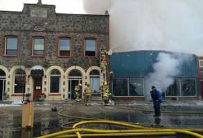 A large fire in Quincy that began in a pizza place destroyed four businesses Sunday morning, according to the Quincy Fire Department.