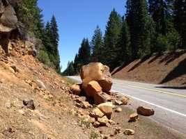 An earthquake in far northeastern California was felt by thousands of people as far away as San Francisco, Sacramento and in two other states. Yet, there were no reports of injury or serious damage. This photo shows a boulder that fell into the roadway in Plumas County after the May earthquake.