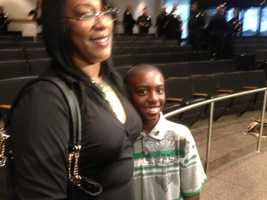 Malik Harvey, 11, with his mother (Dec. 18, 2013).