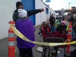 Dozens of people camped out overnight in tents and sleeping bags in front of the Stockton Emergency Food Bank hours before the center gave away more than 2,000 traditional Christmas food boxes Thursday morning.