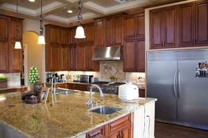 The kitchen features built-in appliances, range, side-by-side refrigerator and two ovens and wine refrigerators.