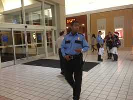 A police officer walks through the West Valley Mall in Tracy.