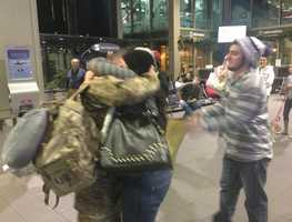 A member of the National Guard, home from Afghanistan, is welcomed home with a hug at Sacramento International Airport on Christmas Eve.