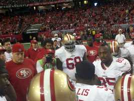 San Francisco 49ers players gathered together after their win in the NFC Championship game against the Atlanta Falcons, which sent them to the Super Bowl in New Orleans.