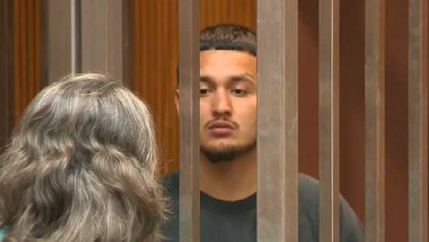 Abraham Arroyo, 21, speaks with his public defender at this court appearance on Thursday.