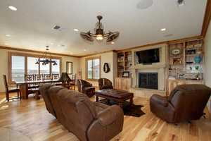 The home has an open floor plan with a spacious family room and a dining area that overlooks the pool.