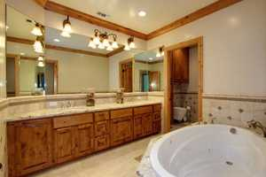 The master bath is complete with a jetted tub, steam shower and bidet.