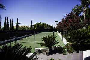 If you feel like an outdoor workout, the home comes with a tennis and basketball court.