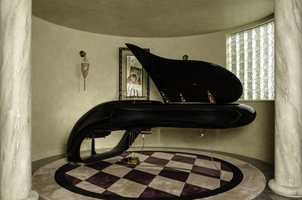 All of the home's furnishings go to the buyer, including a Luigi Colani designed Schimmel Pegasus piano, one of 14 known to exist.