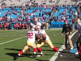 The San Francisco 49ers warm up for their NFC playoff game against the Carolina Panthers.