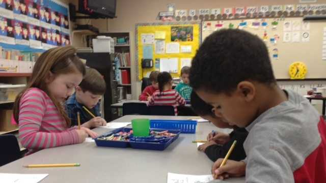 Kindergarten students do class work inside Roseville's Sergeant Elementary School.