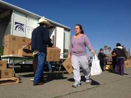 People line up for food handouts in the Central Valley town of San Joaquin.