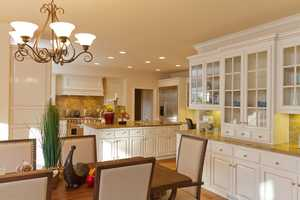 The impeccable built-in custom cabinetry lines the dining and kitchen area.