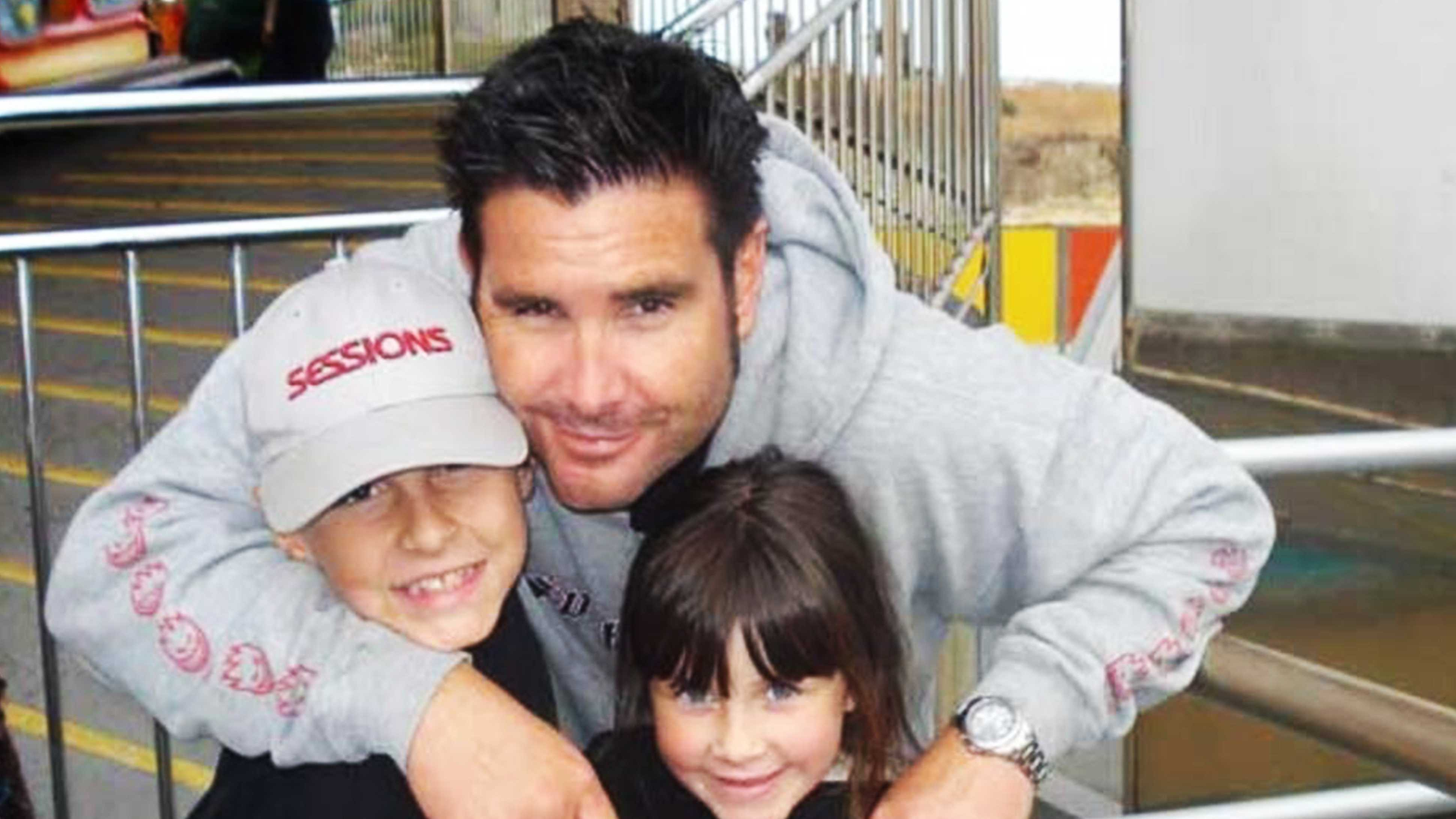 Bryan Stow smiles with his two kids.
