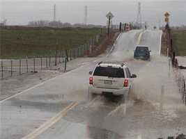 Only a few brave drivers drove through a flooded Scott Road in eastern Sacramento County.