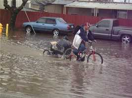 Flooding in the Stockton area made it difficult for many drivers, even those on bikes.