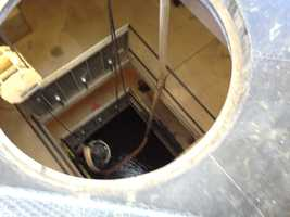A pipe has been dropped down into the center of the pumping station to suck sediment from the river bottom.