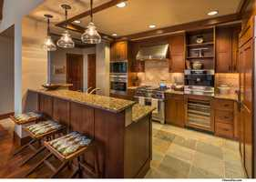 The Ritz-Carlton Residences are appointed with top-of-the-line appliances and high-quality materials, including marble countertops and walnut floor planks.