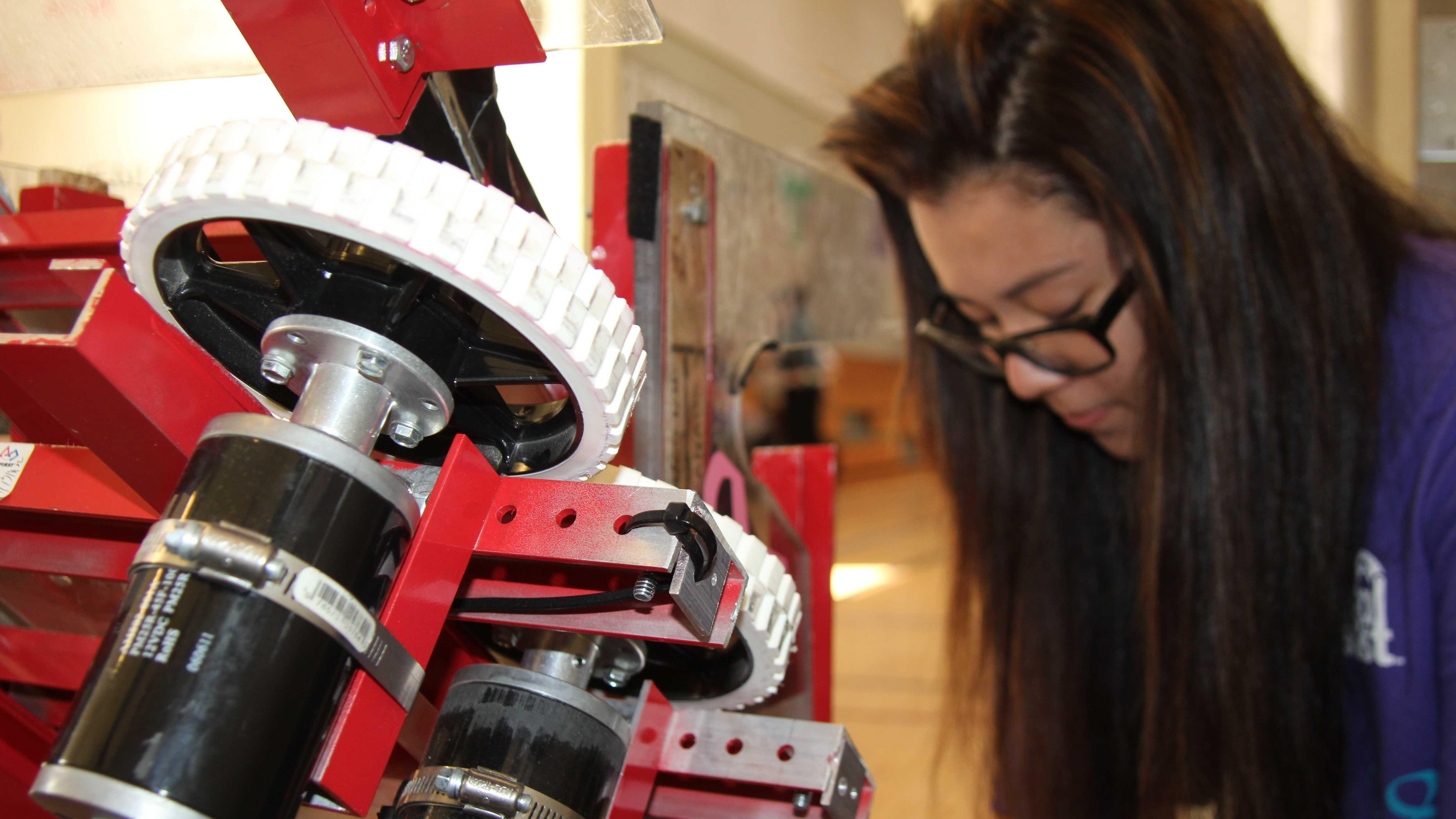 Jordin Fong works on her robot.