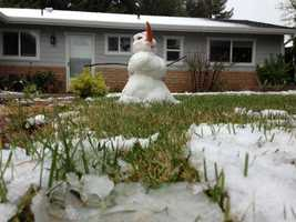 A snowman with an oversized nose graces the front lawn of an El Camino home.
