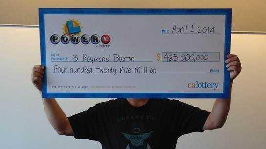B. Raymond Buxton claims his $425 million Powerball winnings. (April 1, 2014)