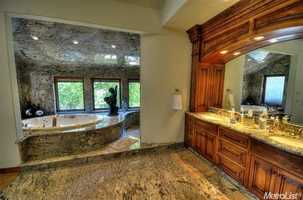 The master suite bathroom has this bathroom and tub. The views are stunning and overlook the east side of the river.