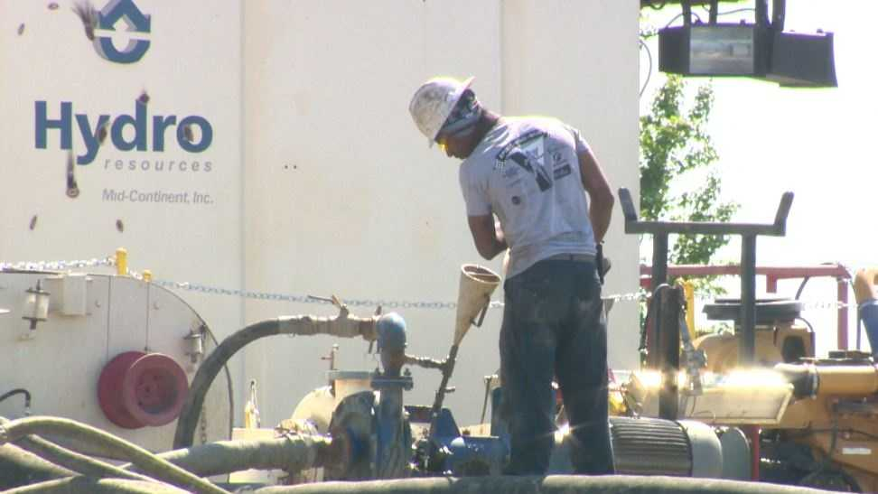 A worker helps drill a new water well for the city of Sacramento.