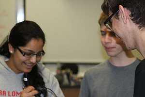 Senior Preethi Raju works with sophomore Jack Gurev and fellow senior Matt Kempster.