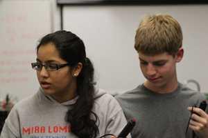 Senior Preethi Raju and sophomore Jack Gurev collaborate.