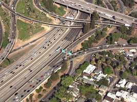 The portion of Highway 50 that is undergoing construction, known as the W/X Freeway, is a set of 2,530-foot-long elevated structures over the city of Sacramento between 18th and 24th streets.