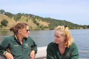 Women's varsity 8 rowers Caroline Boals (left) and Hannah Churchill (right).