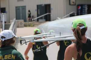 The women's varsity 4 heads for the boathouse.